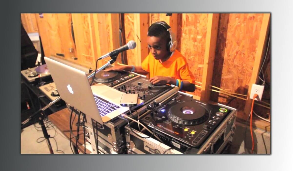Young DJ practicing and very concentrated!
